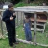 Harmony Korine explains to Michael-Joel David Stuart how to hold a chicken